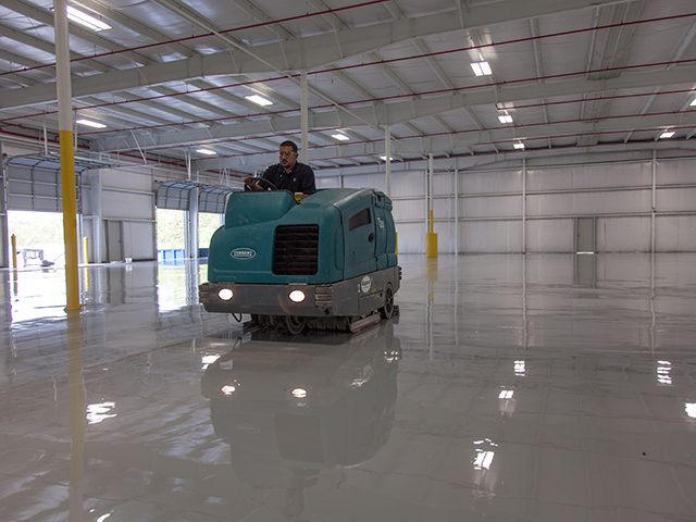 Liquid floors industrial epoxy flooring and concrete for Scrubbing concrete floors